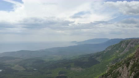 krím : Amazing Aerial view of rocks, forests and sea in Crimea. Flight along a cliff in Crimean Mountains. Stock mozgókép