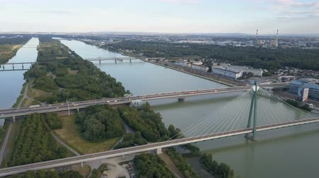 binnenstad : Aerial view of modern Vienna city . Flying over danube bridge with crossing traffic