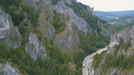 precipicio : Aerial view of a mountain road in a beautiful deep gorge. Cars move on a mountain road.