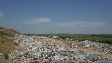 çöplük : Aerial view of City garbage Dump. Gulls Feeding on Food Waste Fly Over It. Stok Video