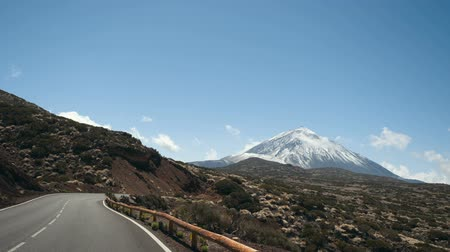 krater : Driving a car in Teide National Park, Tenerife, Canary Islands, Spain. Volcanic rocky desert landscape Stok Video