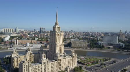 Aerial view of hotel Ukraine in Moscow. Old Soviet Russia Stalin high-rise skyscrapers in heart of modern Moscow City. Kutuzov avenue day traffic.