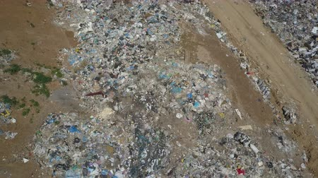 separação : Aerial view of City garbage Dump. Gypsy family with children separates trash to gain some money