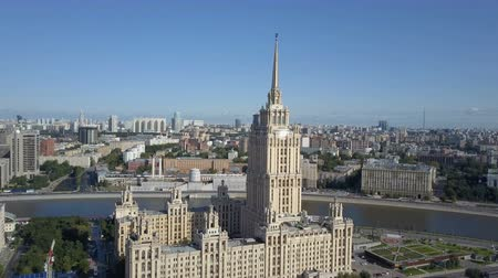 stile impero : Aerial view of hotel Ukraine in Moscow. Old Soviet Russia Stalin high-rise skyscrapers in heart of modern Moscow City. Kutuzov avenue day traffic.