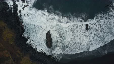 kanarya : Aerial top view of ocean waves breaking on dark rocks on black sand beach, Canary Islands, Tenerife, Spain