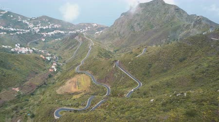 アセント : Aerial view of traffic on a serpentine road in Tenerife, Spain. Canary Mountains covered with green plants.