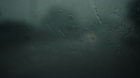 weather conditions : Car wipers cannot remove heavy rain from a car windshield during storm, difficult driving conditions.