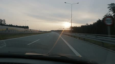 steady cam : POV driving along a wide empty morning road early in the morning during sunrise.. Point of view driving, view from inside the car on on the autobahn in Poland.