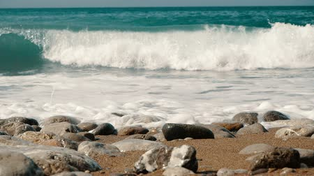 krym : Big waves are crashing on stones and spraying in Slow motion. Beautiful Beach in Crimea with stones and sand.