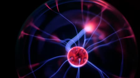 conductivity : Plasma ball, Tesla lamp, Plasma globe with high voltage lightning. Coil experiment with electricity. Plasma lightning ball. Discharge lamp. Inert gas discharge tube. Stock Footage