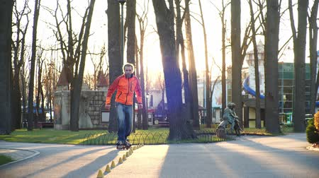 roller blading : A professional roller with excellent riding technique and good stretching makes difficult turns around the cones for training in a cool autumn park. Bottom view in slow motion. Healthy life. Stock Footage
