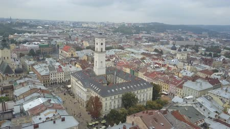 часовня : Beautiful shot from above the outstanding Town Hall of Lviv, which is located in the city center. Bewitching top view of the houses and sights of the historical city of Ukraine in slow motion.