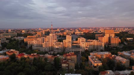 sovyet : Far-off shot of Derzhprom from above - the famous Ukrainian building and sight of Kharkov, as well as Karazin University, which are located on Freedom Square. Sunset behind the drone