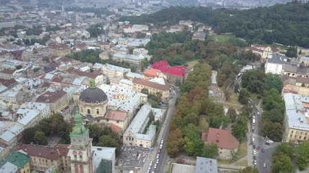 assumption : Ukrainian old city of Lviv in late autumn, drone shooting from above. Famous historical attractions such as the Assumption Cathedral, Dominican Cathedral and simply the roofs of houses in slow motion.