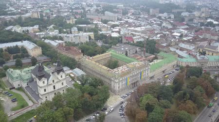 michael : Top shot of the outstanding Church of St Michael, Barefoot Carmelite Church, and the administration building in Lviv, top view in slow motion. Drone shooting the old houses of Lviv from above.