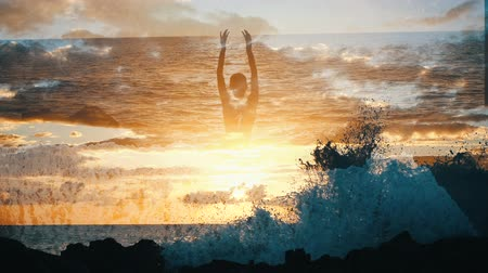 гром : Silhouette of a woman in the sky over ocean raising arms in at sunset. Girl observes waves raising up in the air in slow motion and dramatic colourful clouds. Water surface against clouds at sunset