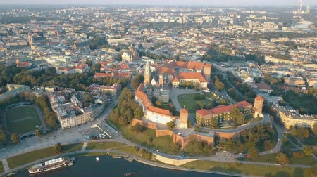 kazimierz : Aerial view of Royal Wawel Cathedral and castle in Krakow, Poland, with Vistula river, park, yard and tourists at sunset. Old city of Krakow in the background