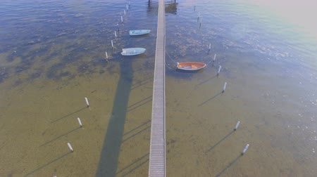 Aerial view of a Wooden pier with attached boats a summer day Stockvideo