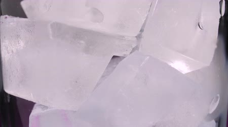 aerated : Close up of a glass that is full of ice cubes Stock Footage