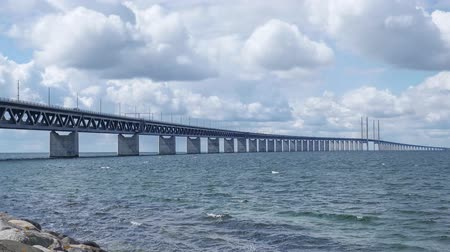 copenhagen : Timelapse Oresundsbron with blue sky and white clouds. The bridge between Sweden and Denmark. Stock Footage