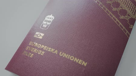 идентификация : Swedish EU Passport close up. Dolly movement along passport Стоковые видеозаписи
