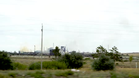 társult : Metallurgical plant in the city of Temirtau, Kazakhstan. On the horizon there are chimneys that pollute the atmosphere. Stock mozgókép