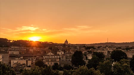 rzym : cityscape at gold sunset on Rome. Saint Peter Dome silhouette on horizon. timelapse landscape