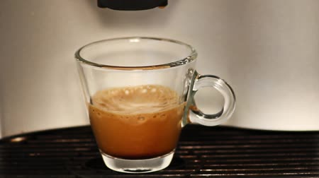 expressed : making espresso coffee in glass cup Stock Footage
