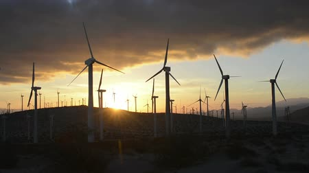 Калифорния : A group of wind power generating mills in the mountains of Palm Springs, California during an early morning sunrise.