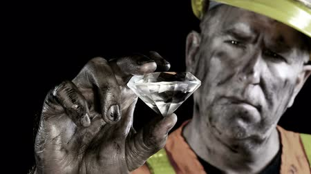 treasure : Conceptual video of a precious gem miner examining his giant diamond discovery.