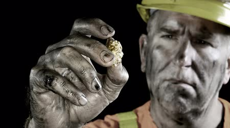 hijenik olmayan : Conceptual video of a gold miner examining his giant precious metal discovery.