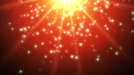 boŻe narodzenie : Gold light rays with falling stars on a vibrant red gradient shows the excitement of the holiday season.  Video is looped for buyer convenience.