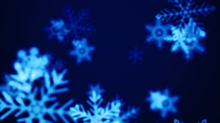 Beautiful animated Christmas snowflake on a blue holiday background for use as is or with any seasonal text or graphic elements. Video is looped for buyer convenience. Stok Video
