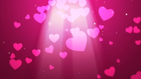 czerwone tło : Valentines video background with white light rays and falling hearts emphasizing love and romance can be used for placement of copy or as a design element Wideo