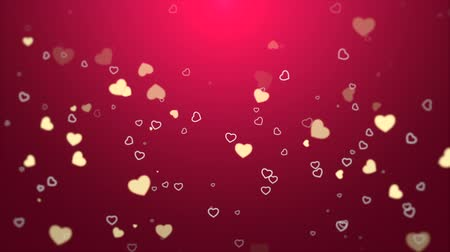 pettyes : A beautiful pastel red Valentines video background with rising white and yellow hearts framed against a spotlight background. Perfect for placement of copy and for use as a design element for weddings or for romantic occasions. Stock mozgókép