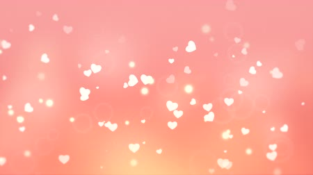 pettyes : A beautiful pastel pink and yellow Valentines video background with rising, beating white hearts framed against a subtle background. Perfect for placement of copy and for use as a design element for weddings or for romantic occasions. Stock mozgókép
