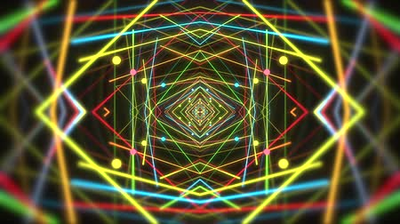 renkli arka plan : Psychedelic clip showing the formation of colorful yellow red green and blue shapes and lines complementary color mixes and unique patterns on a black background for use as retro 1970 style backgrounds or general backdrops for screen savers and wallpaper. Stok Video