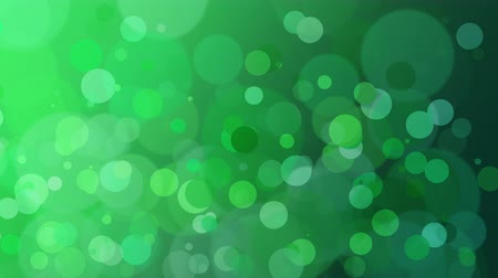 боке : St. Patricks animation with green bokeh and a subtle vignette for use as a background or design element for placement of text or other copy.