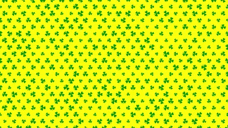 наложение : St. Patricks animated clovers against a yellow background. For use as a general backdrop, design element or as an overlay for placement of text or other copy. Стоковые видеозаписи