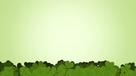 разброс : St. Patricks animated clovers against a green background. For use as a general backdrop, design element or as an overlay for placement of text or other copy.
