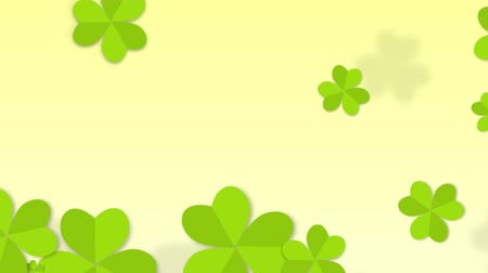 разброс : St. Patricks animated clovers against a white background. For use as a general backdrop, design element or as an overlay for placement of text or other copy. Стоковые видеозаписи