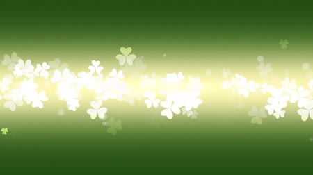 разброс : St. Patricks animated clovers against a green and yellow vignette background. For use as a general backdrop, design element or as an overlay for placement of text or other copy.