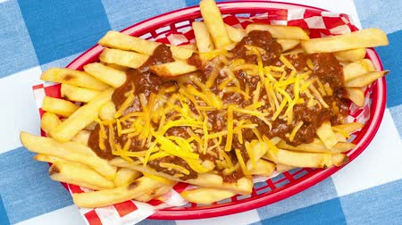 játékpénz : Delicious fresh, hot chili cheese French fries served in a classic red fast food basket