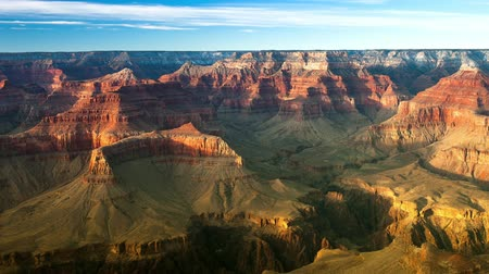 icônico : Pan of beautiful Grand Canyon at dusk shows the rugged terrain and shadows cast from a low sun. Vídeos