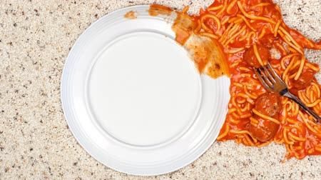 wasted : Pan over an accidently spilled plate of spaghetti on clean carpet leaves a mess for someone to clean up. Stock Footage