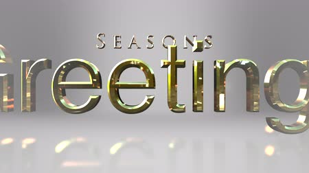 season : Seasonal holiday message of seasons greetings text forming on a gray gradient background for Christmas messaging Stock Footage