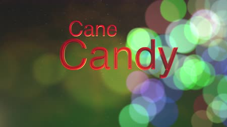 градиент : Candy cane text forming on a colorful bokeh Christmas holiday background for use as seasonal messaging Стоковые видеозаписи