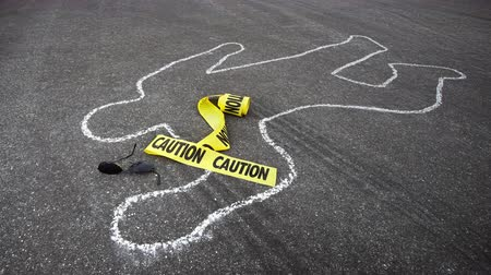 contornos : A police chalk line of a pedestrian who was hit by a car becomes a crime scene