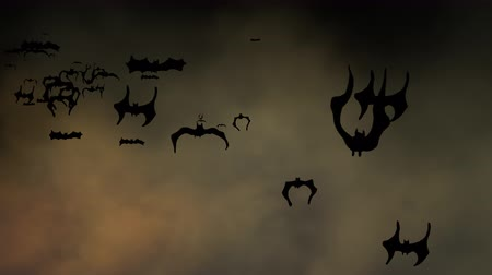 ürpertici : Halloween setting with animated bats flying across a spooky sky. Can be used as a design element for placement of copy and Halloween messaging.