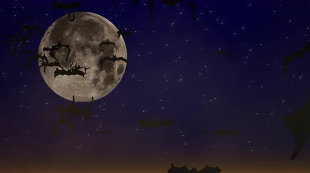 ürpertici : Halloween setting with animated bats flying across a spooky moon and dark blue sky covered with twinkling stars. Can be used as a design element for placement of copy and Halloween messaging. Stok Video